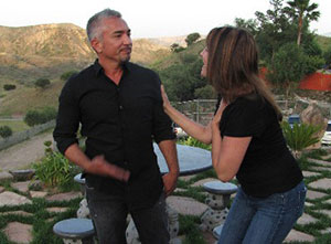 picture of christine and cesar millan taling
